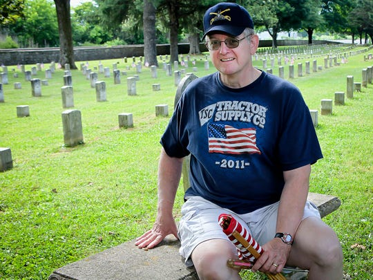 Rockvale resident Steve Brown takes a moment to reflect before flag placement begins. Brown's great-great-grandfather fought at the Battle of Stones River with the Confederates. Brown was on hand with his grandson and Boy Scout Troop 320.