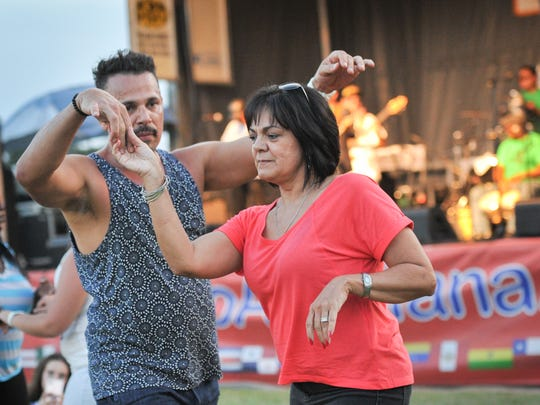 The 2016 Latin Music Festival at the Horse Farm- Moncus Park. October 1, 2016. (Pictured- Daniel Gonzalez and Ann Gaines)