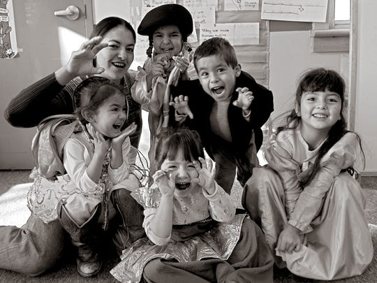 Children play in the Conjunto Preschool in Española in 2003.