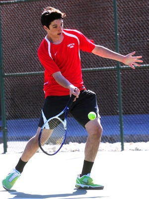 York Country Day's Matt Berland returns the ball to Northeastern's Alex Bretz during Friday's match at York Country Day. Berland defeated Bretz 8-0 in an eight-game pro set. (Daily Record/Sunday News -- Chris Dunn)