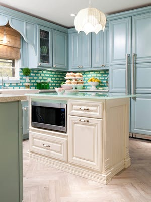"""HGTV Designer and host of HGTV's """"Great Rooms"""" Meg Caswell used crisp, colorful blue green and white fused glass tiles to create a dynamic backsplash in this kitchen. The look is a good blend of contemporary and traditional."""