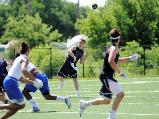 Wylie quarterback Harrison Atwood (19) lets a pass go during the Bulldogs' first Pool C contest in the Abilene 7-on-7 State Qualifier Tournament at The Fieldhouse on Friday. Temple won, 34-14.