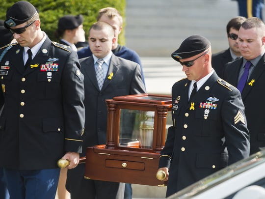 Pall bearers carry Joshua Pallotta's remains during his funeral ceremony at Ira Allen Chapel in Burlington Monday morning. Pallotta, a soldier with the Vermont Army National Guard's Alpha Company, 3rd Battalion, 172nd Infantry, 86 IBCT (Mountain) and deployed to Afghanistan in 2009, took his own life after an ongoing battle with post traumatic stress and traumatic brain injuries.