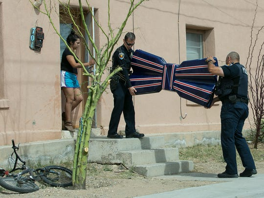 Las Cruces police officers William Gonzales, center,