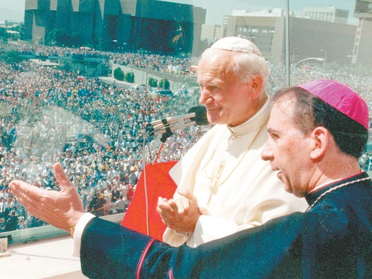 Bishop Thomas O'Brien of Phoenix  (right) gestures