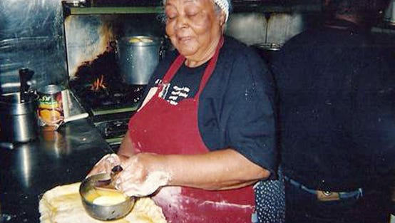 Restaurateur Elizabeth White makes a peach cobbler at Mrs. White's  Golden Rule Café in Phoenix in the late 1990s.
