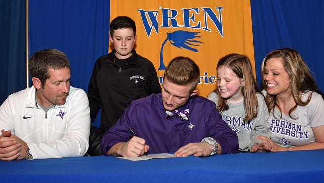 Wren High wide receiver Bailey Rogers, with is parents, Tomy and Jessica Rogers, and his brother and sister, Ashton and Carter, sign a letter of intent to play football at Furman