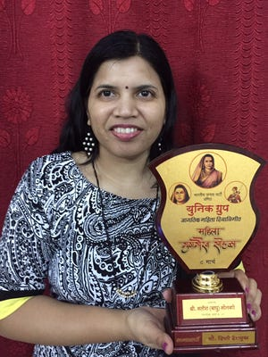 Dipti Kulkarni recieves the Recognition Award for her artwork in Arts Category on International Women's Day by Unique Group at Nashik, Maharashtra, India.