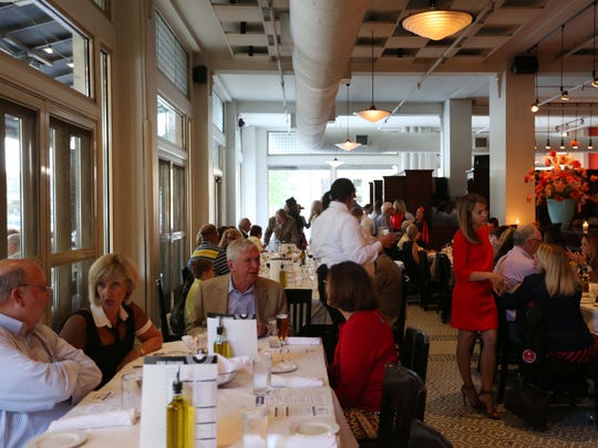 Guests fill the tables at Centro for the Sixth Annual Celebrity Servers Night on Monday, Sept. 28, 2015 in Des Moines. The event is held as a fundraiser for the Young Women's Resource Center.