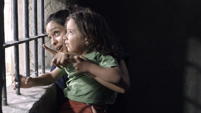 "Layal (Maisa Abd Elhadi) shows her child the sunshine from her prison window in ""3000 Nights."""