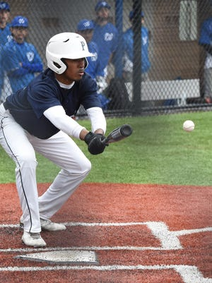 Poughkeepsie's MoQuez Dickens goes for a bunt during Wednesday's game against Wallkill.
