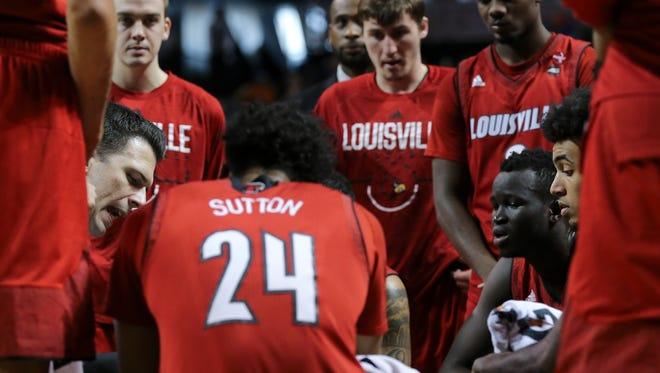 U of L head coach David Padgett, left, drew up a play against Virginia during the ACC Tournament in Brooklyn, NY.    Mar. 8, 2018