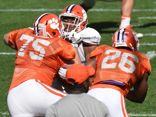 Clemson offensive lineman Mitch Hyatt (75) blocks linebacker