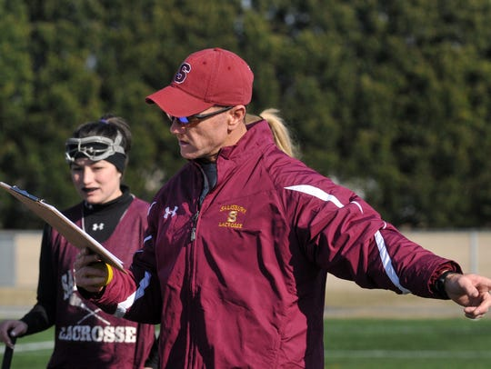 The SU women's lacrosse team coach Jim Nestor during