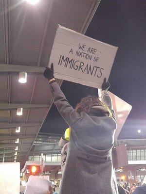 People protesting at JFK Airport on Saturday.