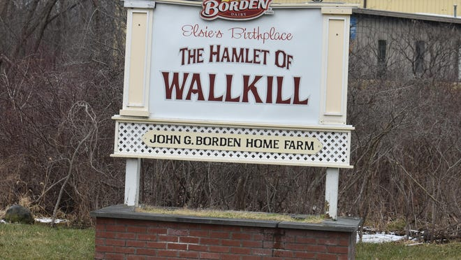 A sign outside the hamlet of Wallkill proclaims it was the birthplace of the Borden Dairy Co.'s famous Elsie the Cow.