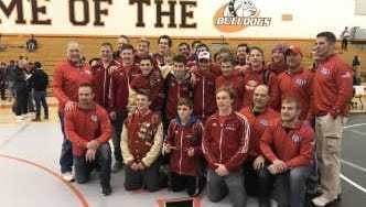 Slinger's wrestlers and coaches pose for a photo after winning the North Shore Conference tournament Saturday at Cedarburg.
