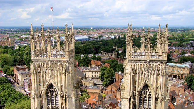 View over the historic city of York, England through the spires of York Minster.