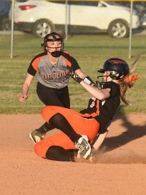 Viola's Keyaira Moore slides past Calico Rock's Kaylee Pool in the 1A-2 North District Championship game Friday night at Viola City Park.