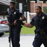 Baton Rouge police officers stand guard on July 17, 2016.