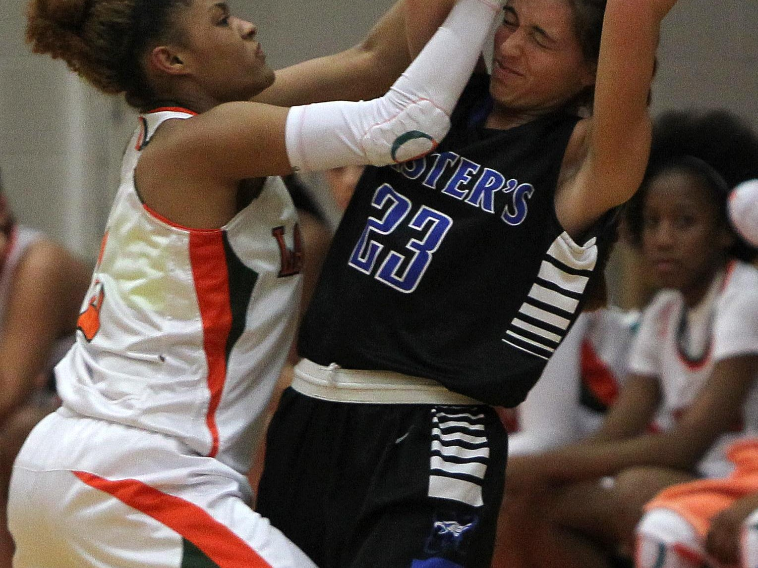 Dunbar's Syanna Brown, left, takes the ball away from The Master's Academy player Jasmine Tuttobene during the Queen of Palms tournament in Fort Myers on Tuesday.