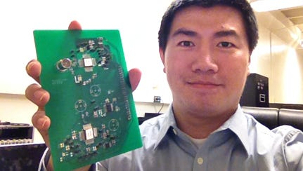 New Mexico State University electrical engineering Assistant Professor Wei Tang shows a test platform of asynchronous radio that he designed for transmitting data from the next-generation of integrated low-power wearable micro-devices.