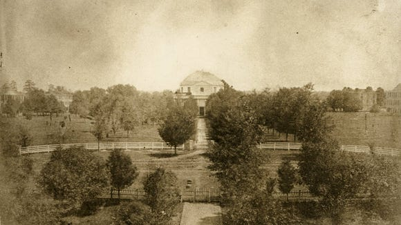 The campus of the University of Alabama in 1859. View of the Quad, with the Rotunda at center and dormitories in the background. All of these buildings were destroyed by the Union army under the command of Brigadier General John T. Croxton on April 4, 1865. University of Alabama Libraries: William Stanley Hoole Special Collections Library (public domain).