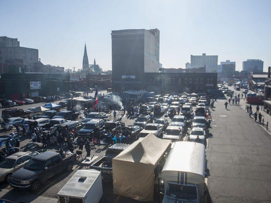 The parking lots at Eastern Market fill up with people before a Lions game.