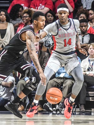 Mississippi State's Xavian Stapleton looks to drive against Ole Miss' Rasheed Brooks on Tuesday. Both teams are 5-5 in the SEC.