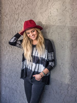 """In June, Kelsea Ballerini's """"Love Me Like You Mean It"""" went No. 1 on Billboard's country radio airplay chart. The accomplishment made Ballerini the first female country solo artist to top the chart with a debut song in nine years."""