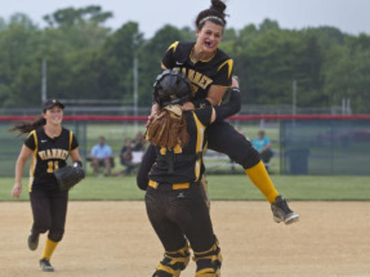 St. John Vianney pitcher Ashley Ventura jumps into the arms of catcher Michelle King after the Lancers won the Shore Conference Tournament championship with a 12-0 victory over Pinelands.