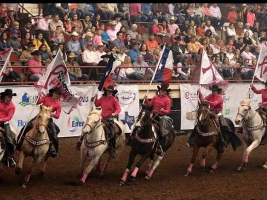 The San Angelo Rodeo Ambassadors drill team rides during Tough Enough to Wear Pink night at the 2016 San Angelo Rodeo.