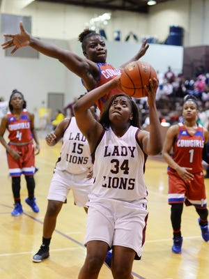 Booker T Washington's Briona Morris (34) tries to get the ball in the basket as Jewel Sumner's Bre' Ashlee Jones(2) tries to stop her during the LHSAA Class 3A girls playoff game Monday evening at BTW.