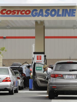 A Costco customer prepares to pump gasoline at a Costco in Redwood City, Calif. The wholesaler has posted a job opening online for a Ridgeland location.