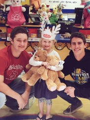 Emery Miller delivers Teddy bears to children in Arizona.