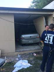 Twp people were injured when a car ran into a building