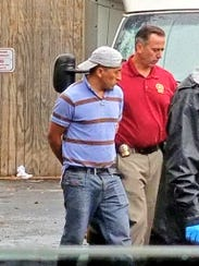 Ramapo Detective Dennis Procter arrests Salomon Cuenca-Ramos