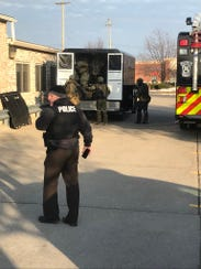 A Special Task Force Unit is on the scene at a robbery at Citizens Bank in Canton Township on Thursday.