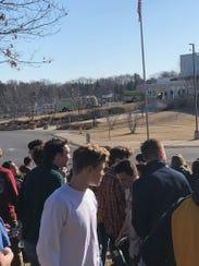 Students look back at Oconomowoc High School after