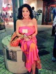 Always fabulous Sharon Moss wears an amazing silk maxi