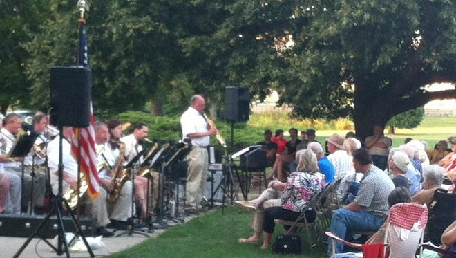 AHB members perform on grounds of E.B. and Bertha C. Ball Center.