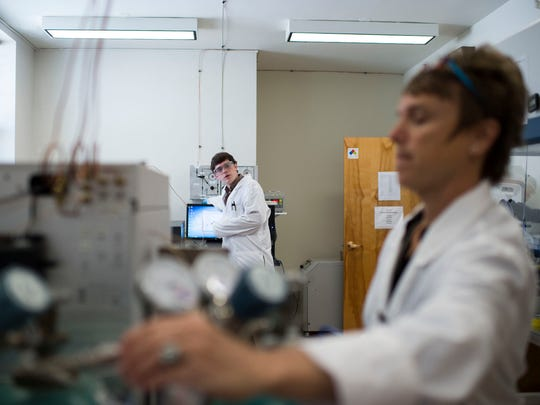 Then lab director Monica Borowicz, at right, works to analyze gases and ensure quality control with commodities on the Antares rocket in 2015. Federal authorities say an employee for a NASA contractor falsified pollution test results at NASA Wallops Flight Facility. Court documents filed April 22, 2019, identified the now ex-employee as Borowicz.