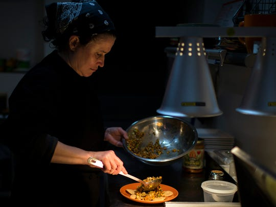 Chef and co-owner Margie Felton prepares a chicken tikka chaat dish inside Chaat and Chai Tuesday, Jan. 12 on Snyder Ave in South Philadelphia.