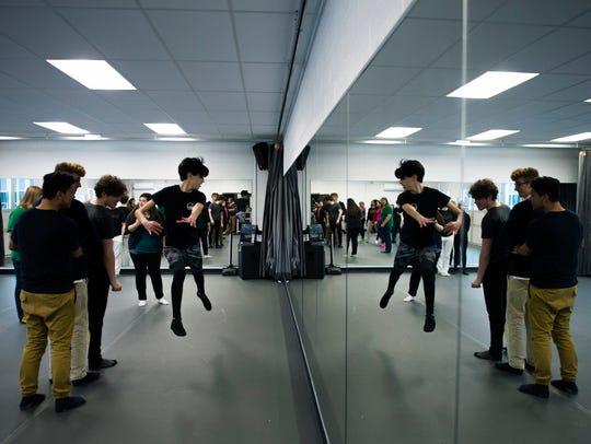 Cap 'n' Dagger members rehearse dance sequences for