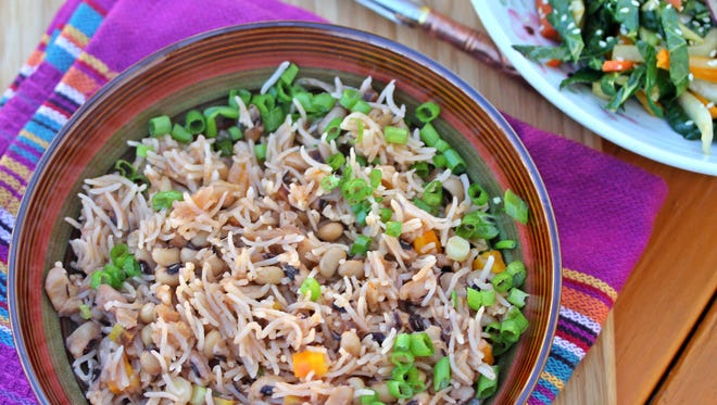 Hoppin John, or cooked rice and black-eyed peas, is said to bring good luck in the new year.
