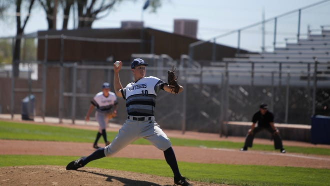 Piedra Vista's Nate Swarts fires a pitch against Sandia during Saturday's 6A playoff game at Ricketts Park. PV will face district foe Volcano Vista in Thursday's 6A quarterfinals at Santa Ana Star Field.