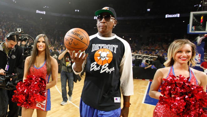 Former Pistons forward Dennis Rodman delivers the game ball before the start of the last game played at the Palace on April 10, 2017.