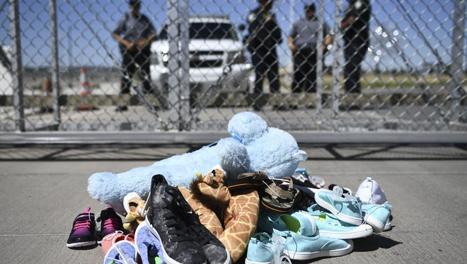 A senior Trump administration official Friday said that about 500 of the more than 2,300 children taken from their families at the border in recent weeks have been reunited since May.