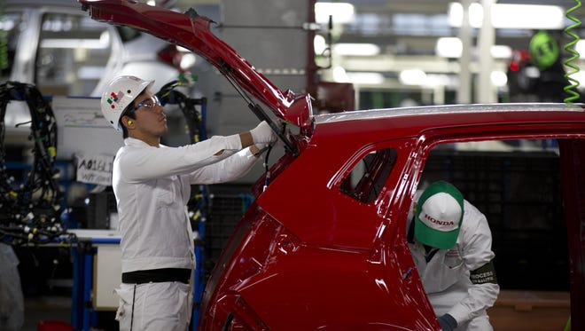 Employees work in the new Honda car plant in Celaya, Mexico, Feb. 21.