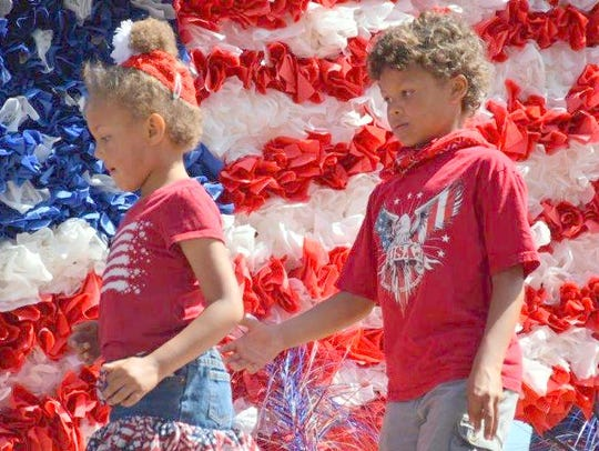 Two youngsters rode on one of the patriotic floats.